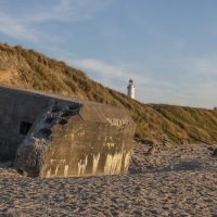 Nazi bunker on beach with lighthouse © Bernd Nies