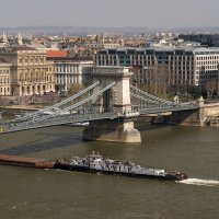 Chain bridge with freight ship