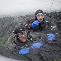 Two divers in an Icehole