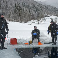 Three divers on an Icehole